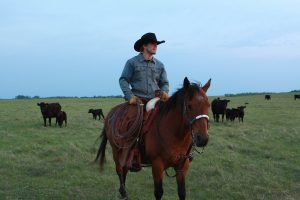 a cowboy riding at Black Leg Ranch ND
