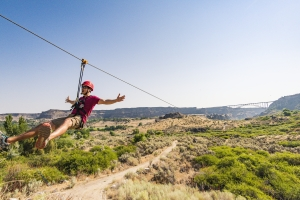 Girls try the zipline at Twin Falls in Idaho