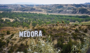 Medora town sign on the mountainside